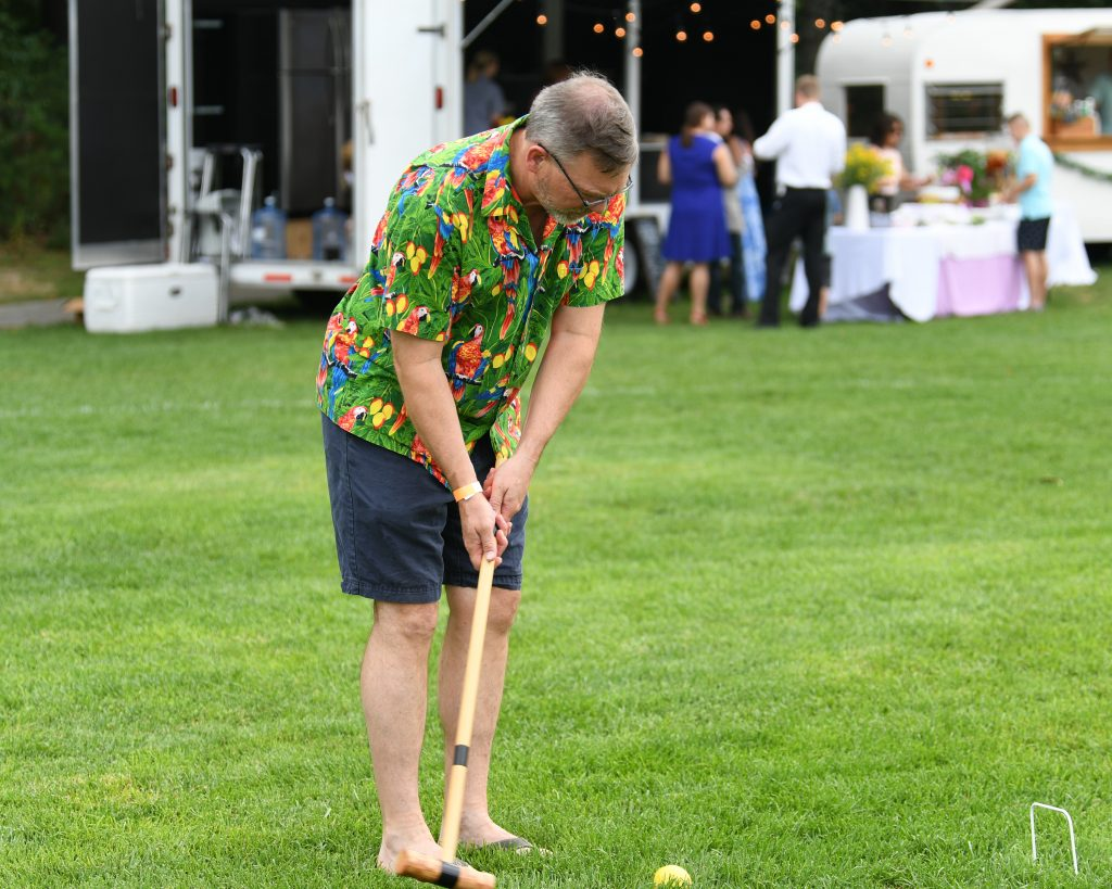 Gary Dake swinging mallet at AIM Services Croquet on the Green event