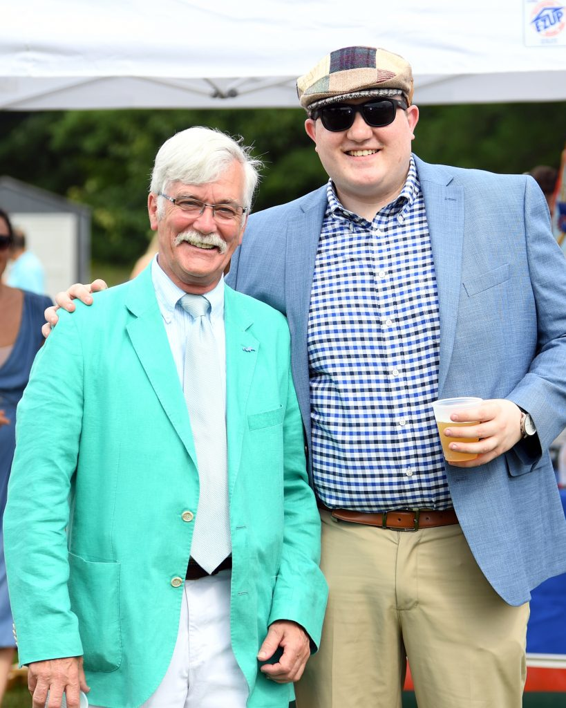 two men in bright blazers at AIM Services Croquet on the Green event