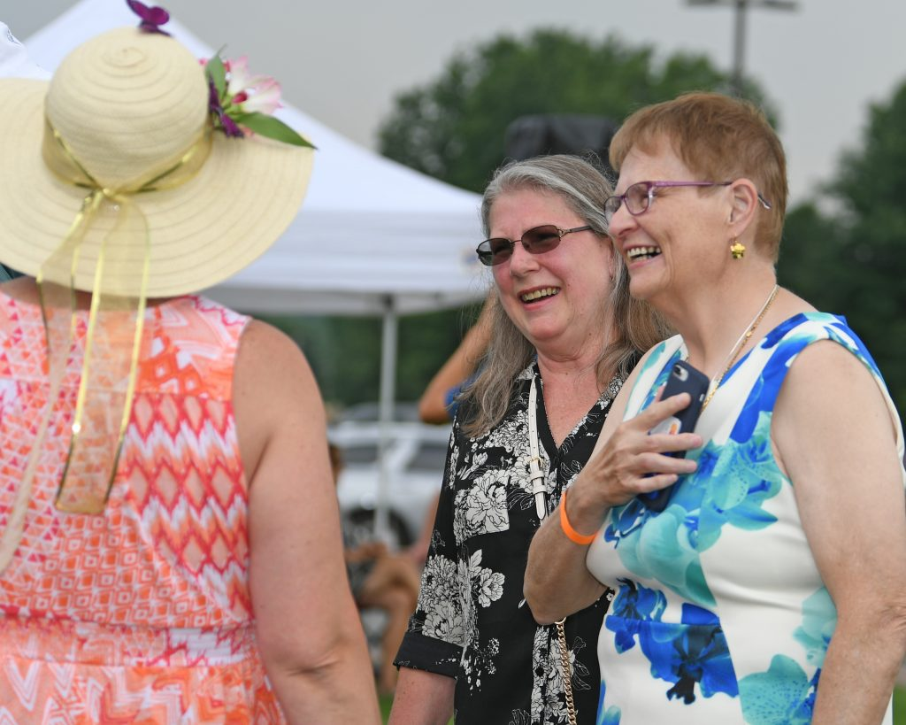 June MacClelland and friends laughing together at AIM Services Croquet on the Green event