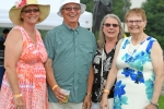 Group of four people smiling at the camera at AIM Services Croquet on the Green event