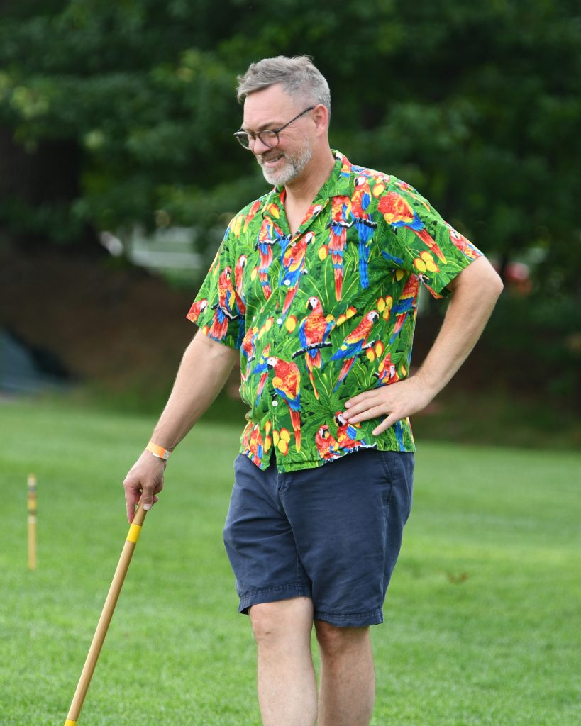 Gary Dake smiling in hawaiian shirt at AIM Services Croquet on the Green event