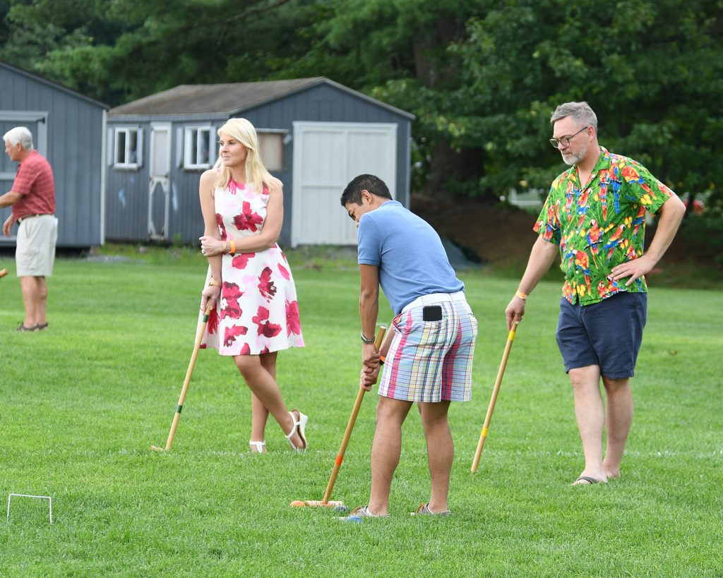 Group of people playing croquet at AIM Services Croquet on the Green event