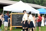Group of people having a good time in front of the score board for Croquet at AIM Services Croquet on the Green event