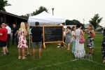 People mingling at AIM Services Croquet on the Green event