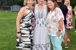 Group of three women at AIM Services Croquet on the Green event