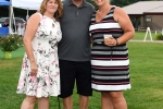 Group of three people at AIM Services Croquet on the Green event