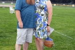 Cudney Cleaner owners pose for a picture at AIM Services Croquet on the Green event
