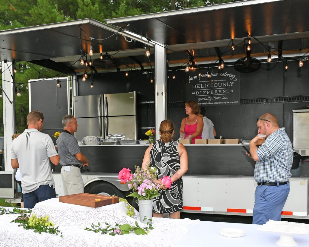 Deliciously different with their new food truck at AIM services Croquet on the Green event