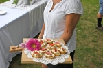 Server from deliciously different with food at AIM services Croquet on the Green event