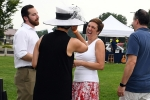 Group of people talking and laughing at AIM Services Croquet on the Green event