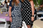 Two woman in pattern dresses at AIM Services Croquet on the Green event