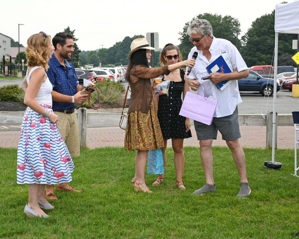Walt annoucing winner of best dressed in front of couple at AIM Services Croquet on the Green event