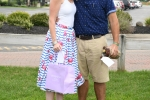 Couple in flamingo themed clothing with winning best dressed prizes at AIM Services Croquet on the Green event
