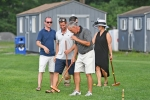 Group of players walking off the field at AIM Services Croquet on the Green event