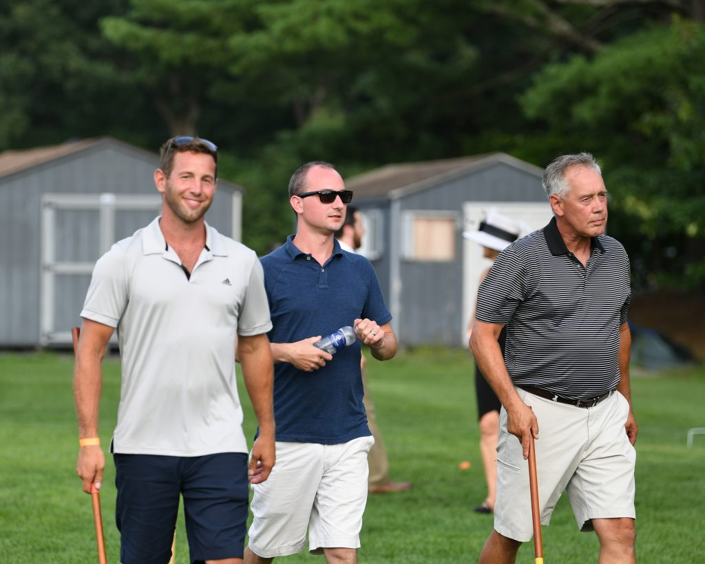 Group of players walking on the field at AIM Services Croquet on the Green event