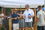 Croquet judge speaking to crowd at AIM Services Croquet on the Green event