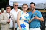 Third place Croquet winner poses with trophy at AIM Services Croquet on the Green event