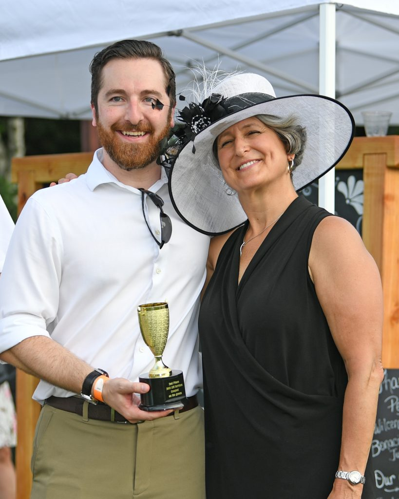 Second place winners pose with trophy at AIM Services Croquet on the Green event
