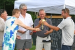Croquet winners receive trophy at AIM Services Croquet on the Green event