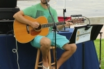 Thom powers playing guitar at AIM Services Croquet on the Green event