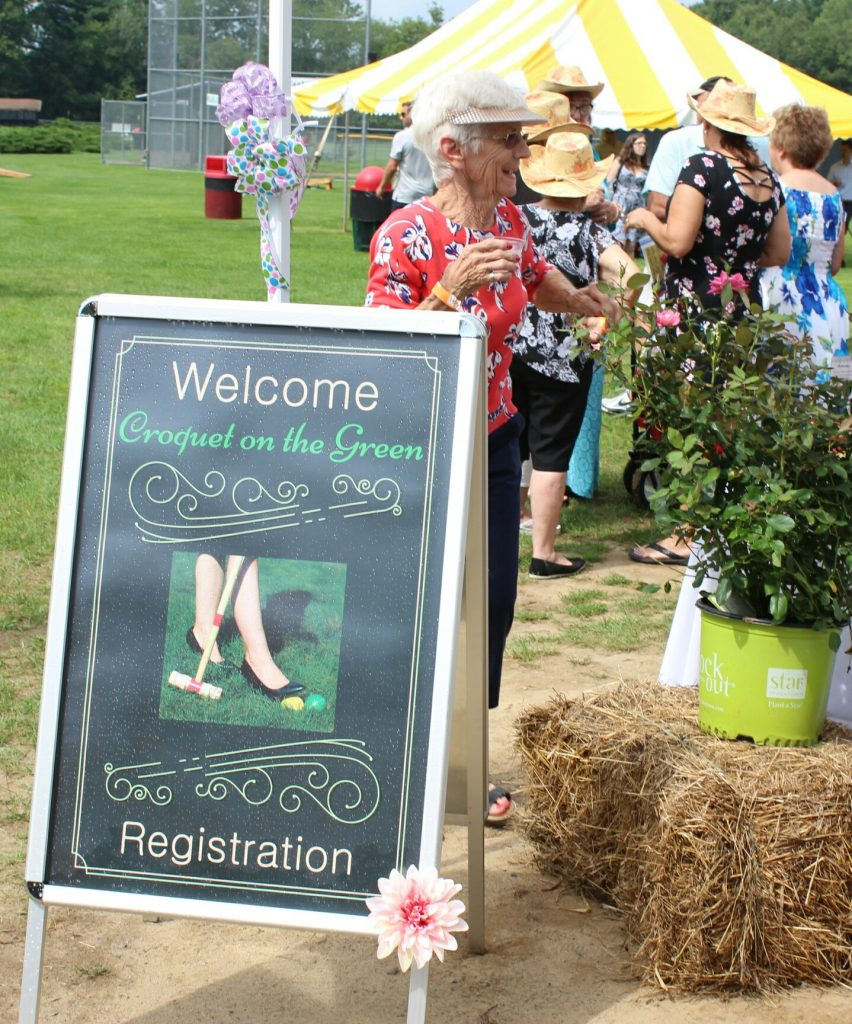 Welcome Croquet on the Green Registration sign at AIM Services Croquet on the Green event