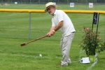 Man swinging mallet at AIM Services Croquet on the Green event