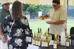 Brian Gwynn of specialty wines and more pouring wine at AIM Services Croquet on the Green event