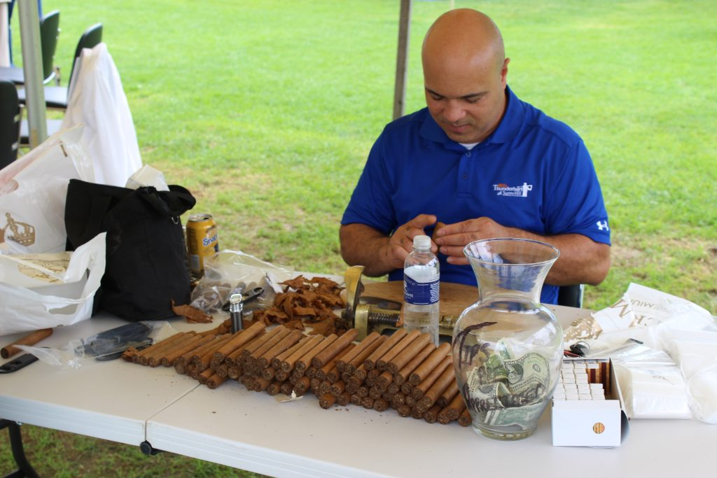 Habana Premium Cigars rolling cigars for guests to enjoy at AIM Services Croquet on the Green event