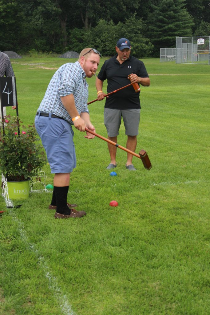 Damon Casey practicing his swing at AIM Services Croquet on the Green event