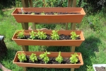 3 Tier Wooden Vertical flower box with plants - AIM Services, Inc.