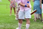 Man in pink shirt and socks hitting croquet ball at Croquet on the Green 2019