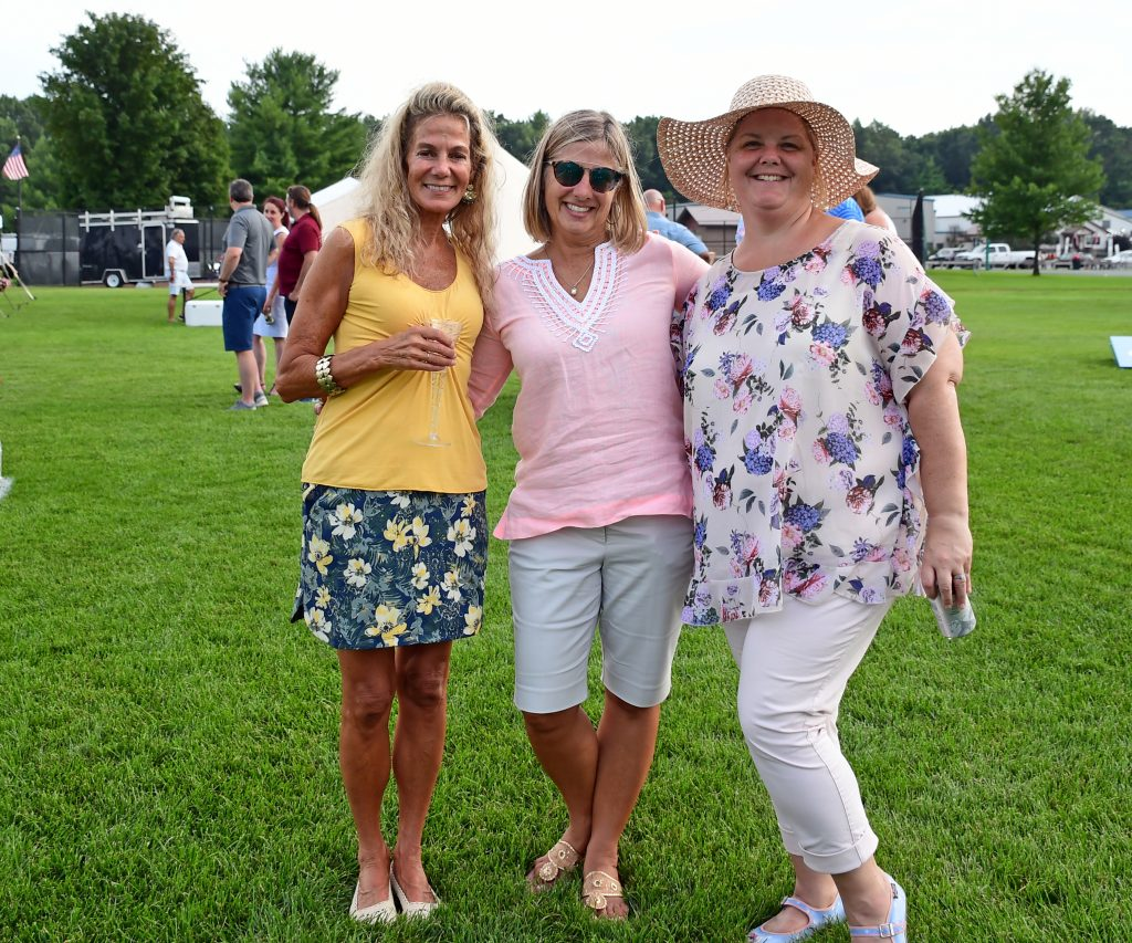 Group of three women smiling at Croquet on the Green 2019