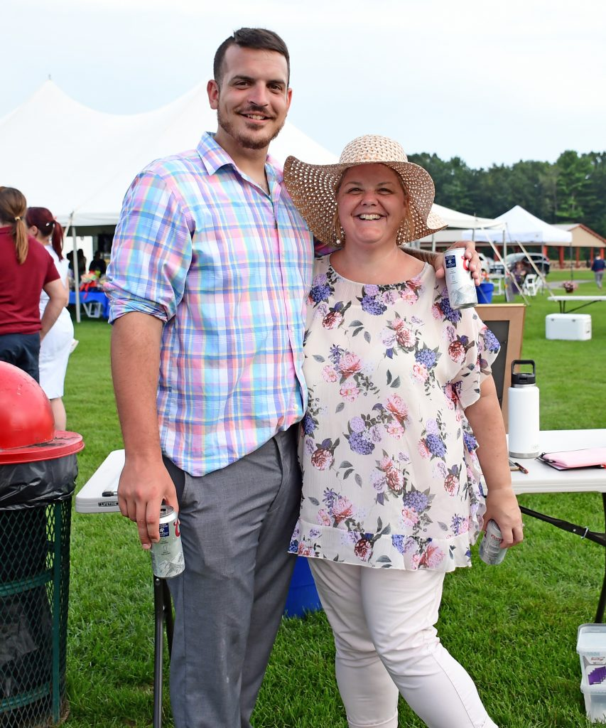 Man and woman holding beers and smiling together at Croquet on the Green 2019
