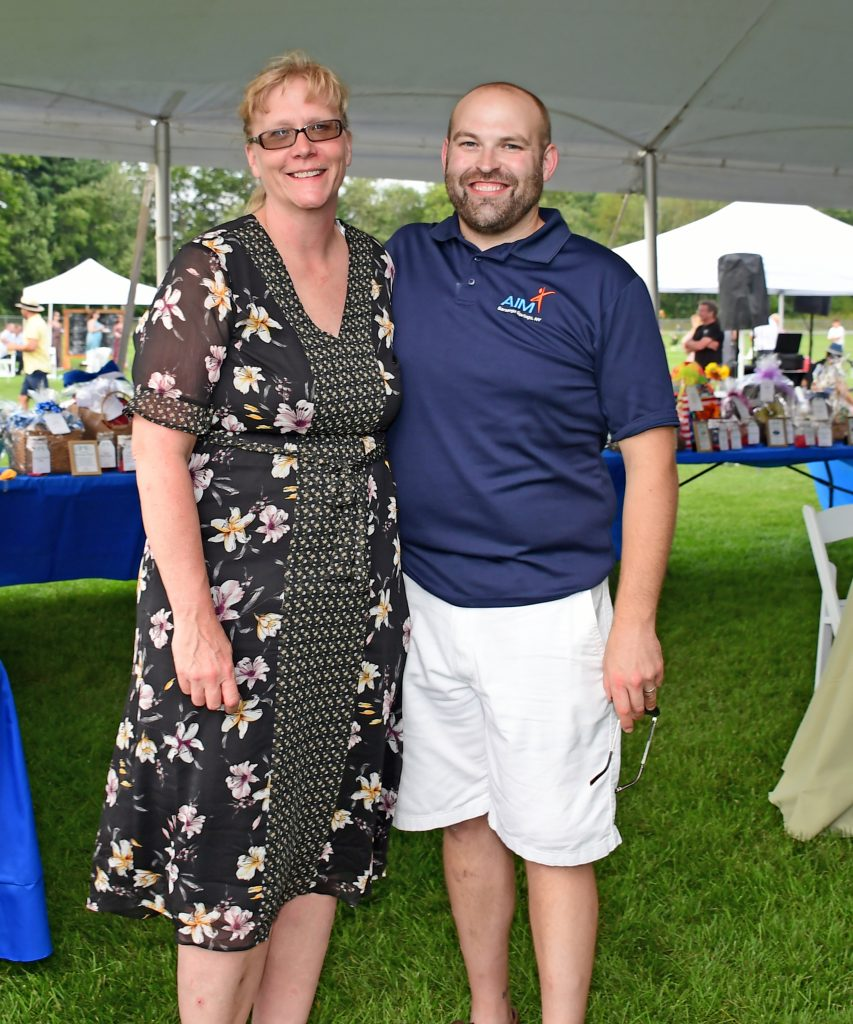 "Elizabeth ""BJ"" Lent and Josh Phelps standing together and smiling at Croquet on the Green 2019"