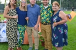 Group of give people smiling with glasses of sparkling wine at Croquet on the Green 2019