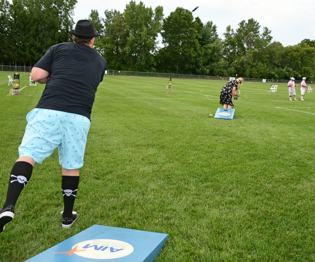 Man throwing cornhole bag at Croquet on the Green 2019