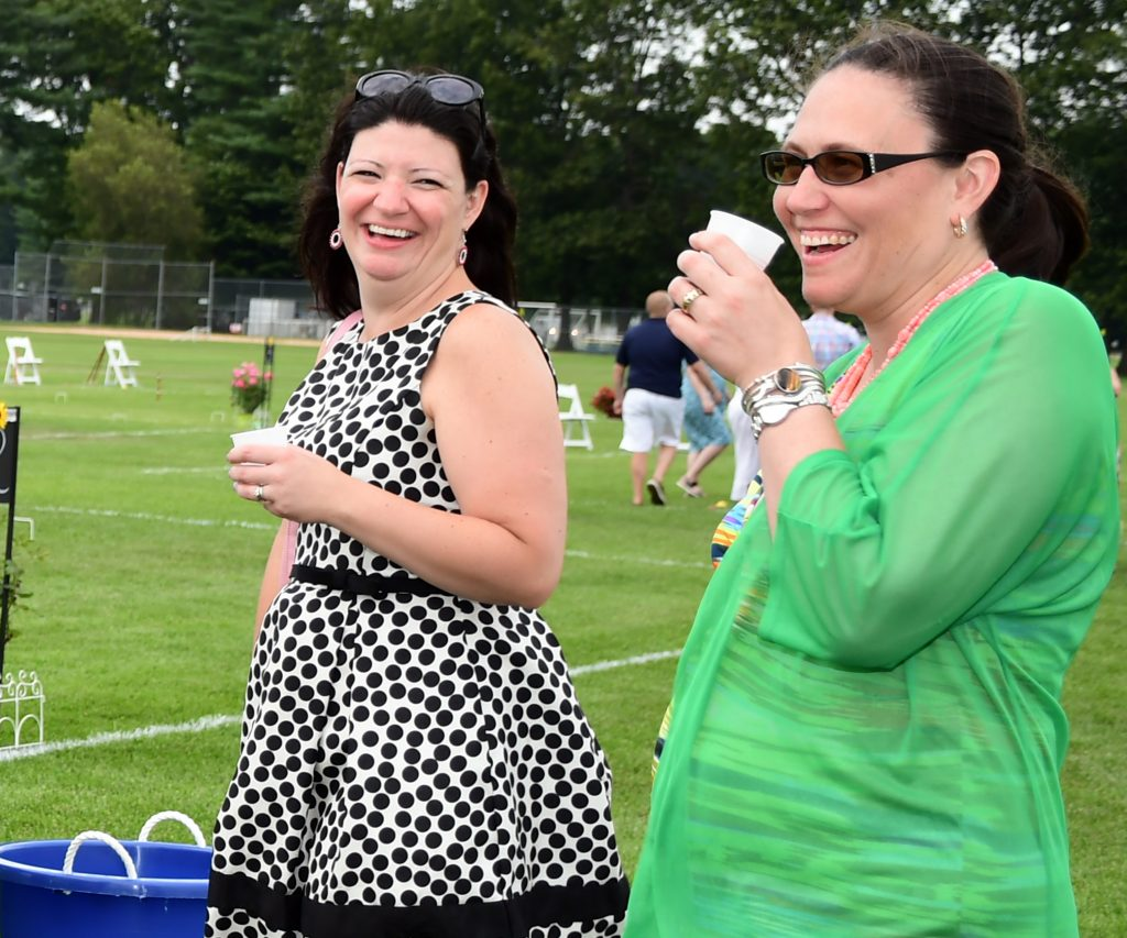 Two women laughing at Croquet on the Green 2019