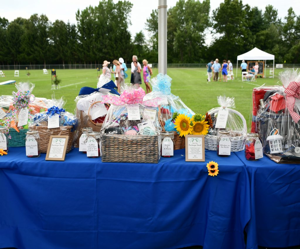 Raffle baskets on blue table