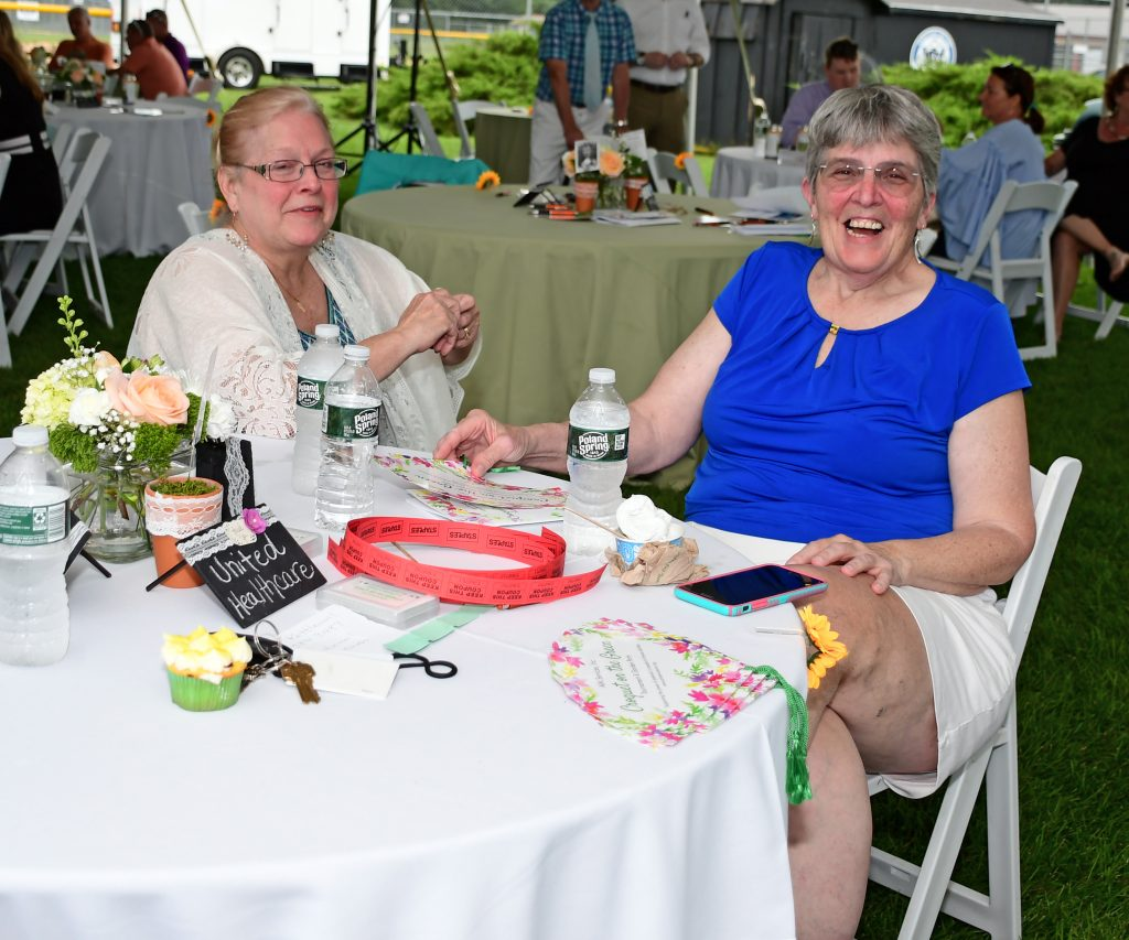 Two women sitting at a table at Croquet on the Green 2019