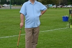 Man in light blue shirt with tan hat standing with croquet mallet at Croquet on the Green 2019