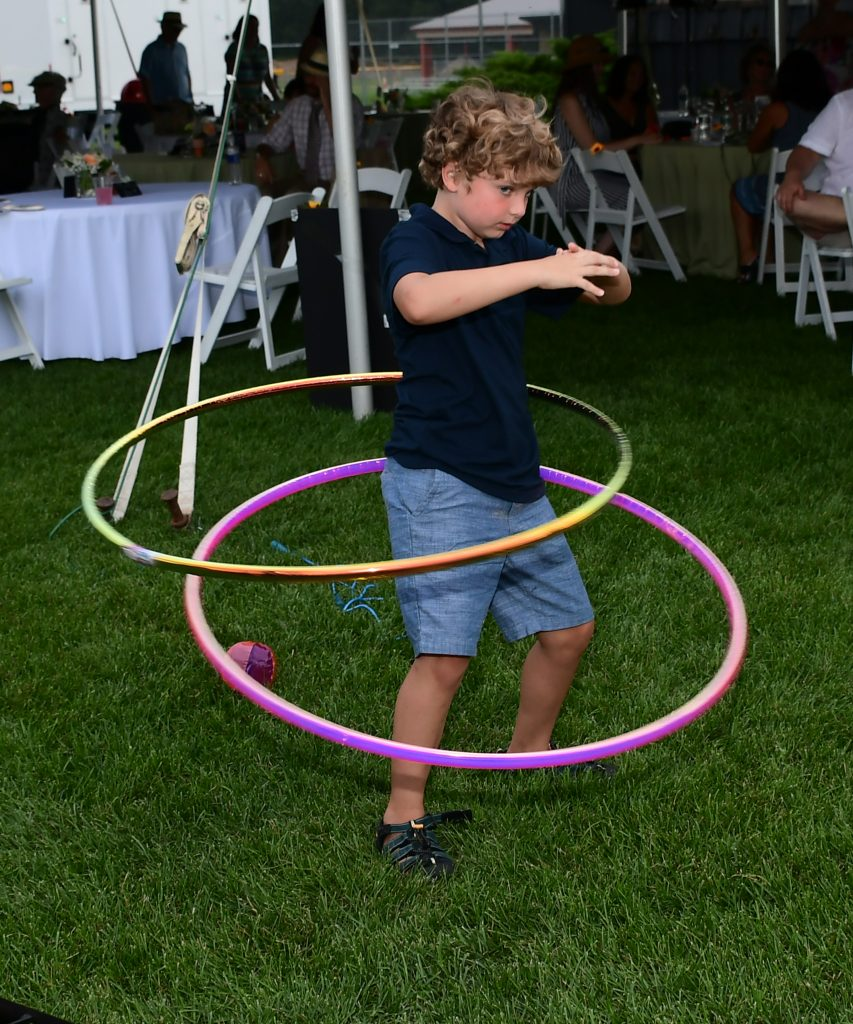 boy hula hooping at Croquet on the Green 2019