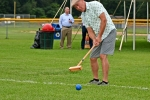 Man hitting croquet ball with mallet at Croquet on the Green 2019