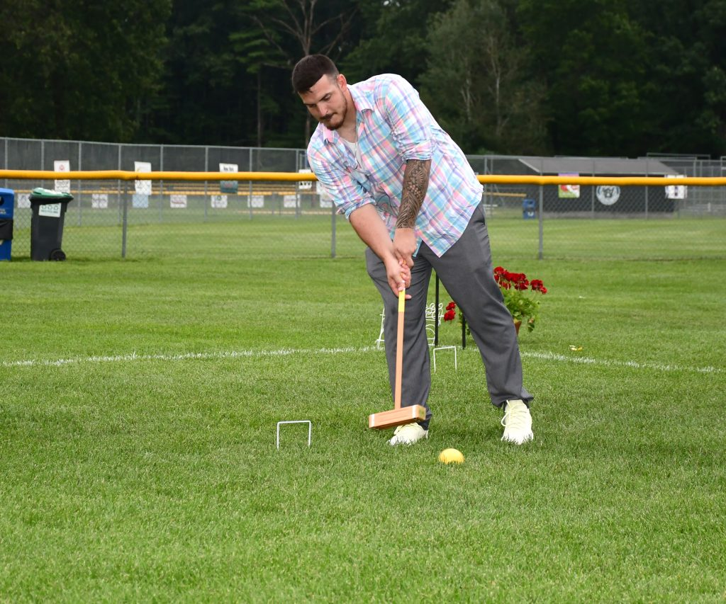 Man hitting croquet ball at Croquet on the Green 2019