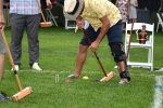 man bent over lining up a croquet shot at Croquet on the Green 2019