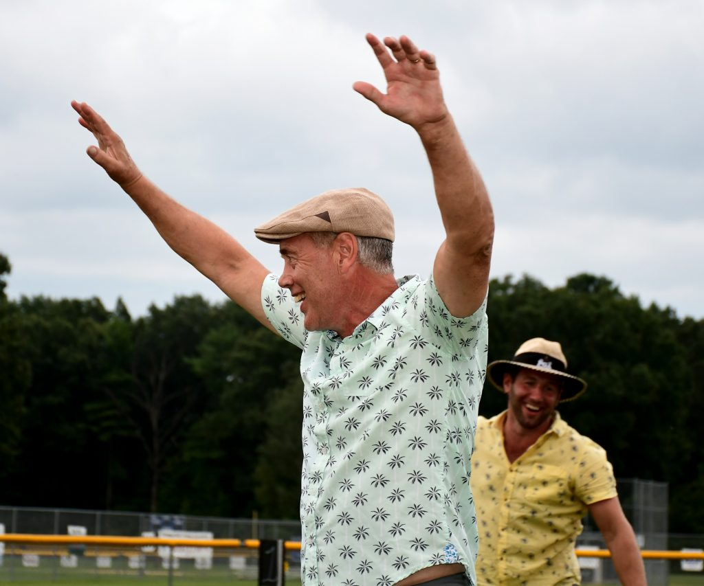 Man throwing his hands in the air with excitement at Croquet on the Green 2019