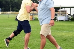 Two men embracing in high five hug at Croquet on the Green 2019