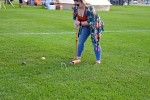 Woman bent over about to take a shot at Croquet on the Green 2019