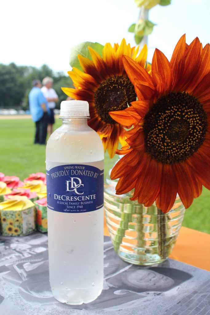 DeCrescente water bottle next to a bouquet of sunflowers at Croquet on the Green 2019