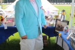 man in teal jacket and white hat dressed up at Croquet on the Green 2019
