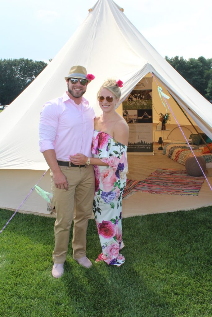 Couple in pink matching outfits in front of glamp tent at Croquet on the Green 2019